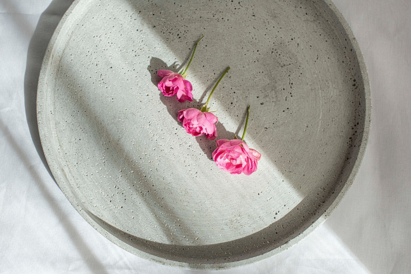 three pink roses on a plate